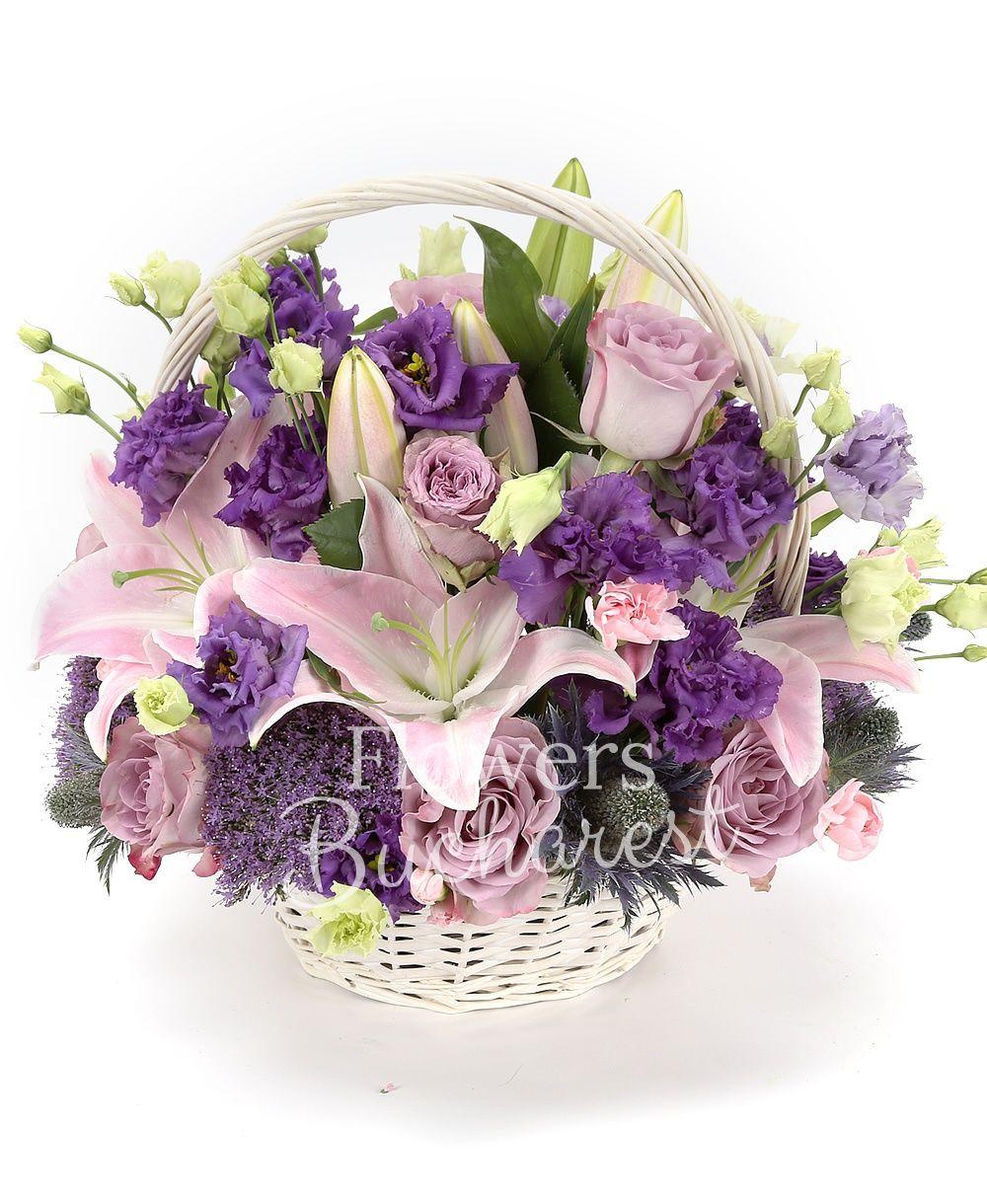 10 purple roses, 3 pink lilies, 5 purple lisianthus, 3 purple trachelium, 3 eryngium, 5 pink carnations