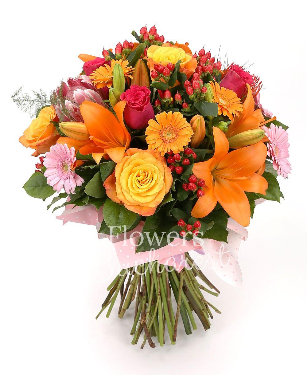 3 orange lilies, 3 proteea, 5 orange roses, 3 cyclam roses, 3 pink gerbera, 5 orange gerbera, 3 leucospermum, 5 hypericum, greenery