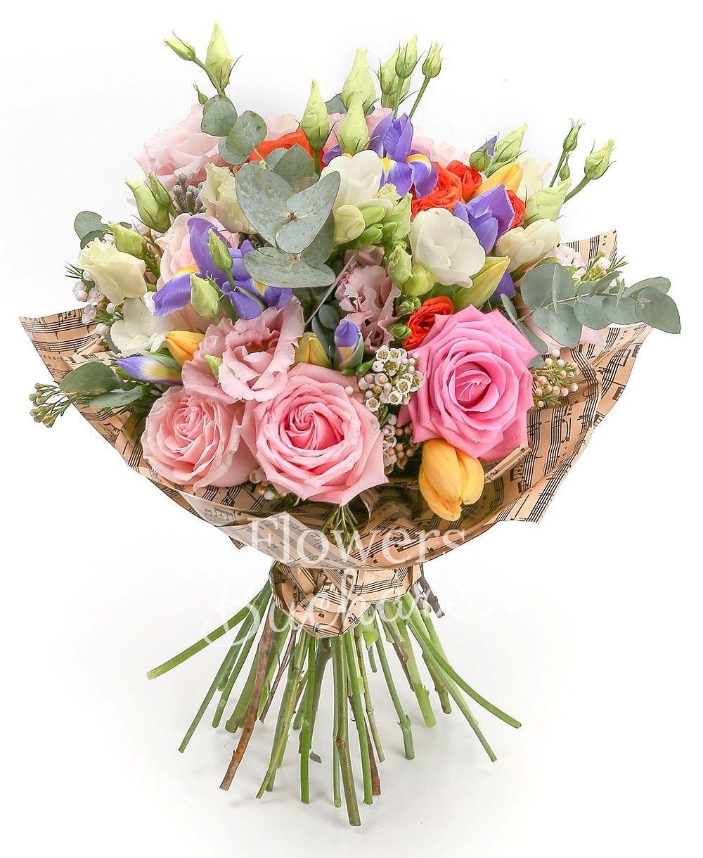 3 pink roses, 5 pink lisianthus, 2 white waxflower, 5 brunia, 5 iris, 3 orange miniroses, 5 yellow tulips, 5 white freesias, greenery