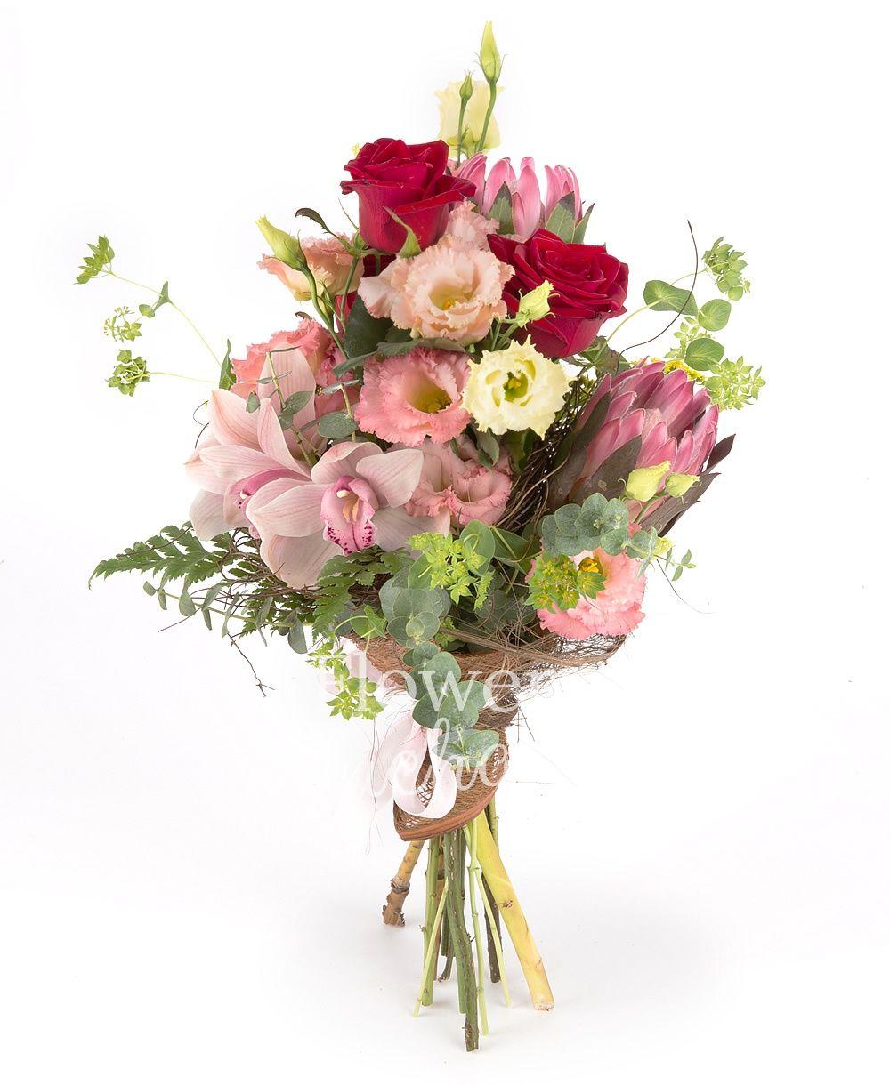 2 proteea, 3 red roses, 5 pink lisianthus, pink cymbidium, 3 solidago, bupleurum, greenery
