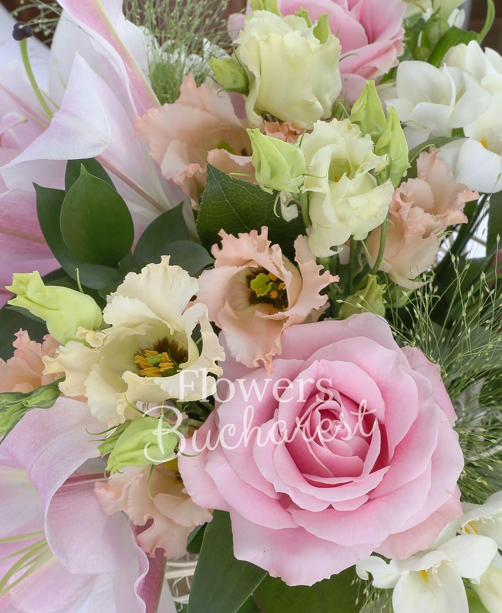 1 pink lily, 3 pink roses, 3 pink lisianthus, 5 white freesias, 2 white alstroemeria, greenery