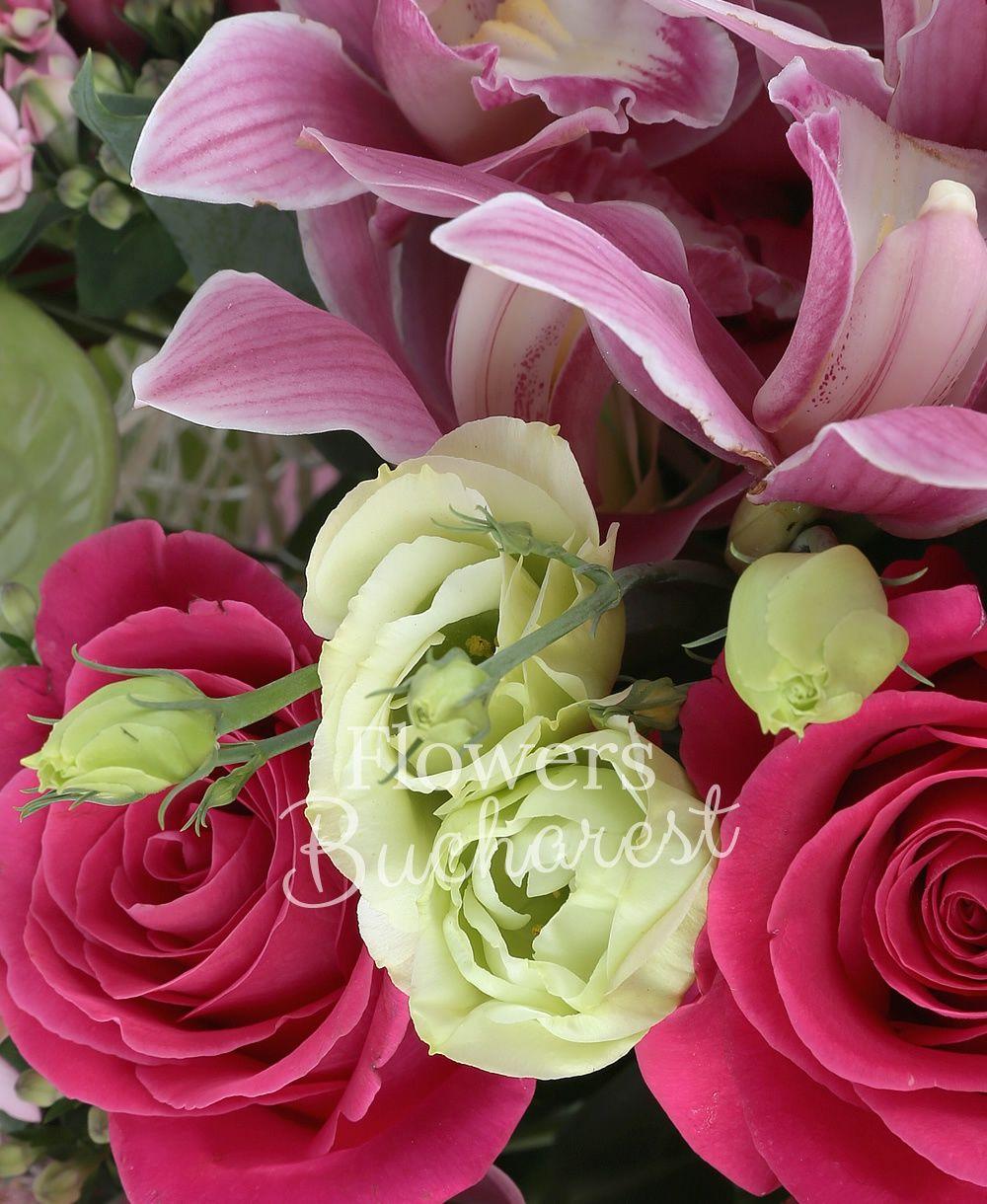 7 cyclam roses, 5 pink lisianthus, 4 pink santini, 7 cream carnations, 3 green lisianthus, 3 sedum, 5 pink bouvardia, 2 green anthurium, pink cymbidium, greenery