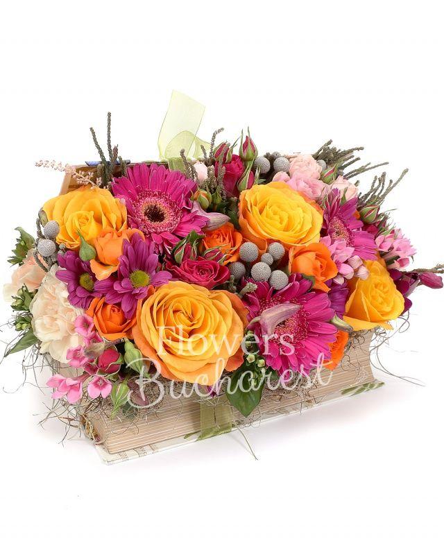 4 trandafiri portocalii, 2 trandafiri roz, 3 gerbera cyclam, 3 bouvardia roz, 3 miniroze cyclam, 2 miniroze roz, brunia, crizantemă cyclam, 5 garoafe crem, carte