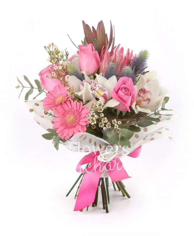 4 trandafiri cyclam, 2 gerbera roz, 2 proteea, 2 leucadendron, 2 eryngium, cymbidium alb, waxflower alb, eucalypt, cuib